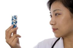 Female Doctor with Pill Stock Photography
