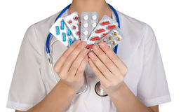 Female doctor with pill holding hand, isolated on white background Stock Images