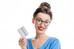 Female doctor with pills Royalty Free Stock Photos