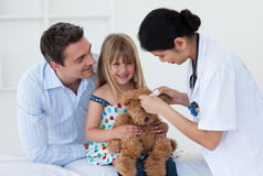 Female doctor playing with her little patient Stock Image