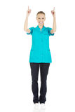 Female doctor pointing up. Stock Photo