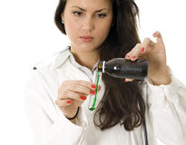 Female doctor pouring to test-glass green liquid Stock Photo