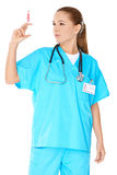 Female doctor preparing an injection Stock Photos