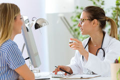 Female doctor prescribing medication for patient. Stock Images