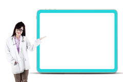 Female doctor presenting copyspace. Attractive female doctor presenting copyspace. isolated on white Stock Images