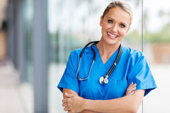 Female doctor. Pretty female doctor looking at the camera Stock Photo