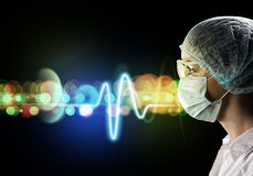 Female doctor in protective mask and glasses Royalty Free Stock Image