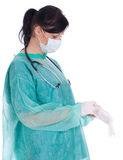 Female doctor pulling on surgical gloves Royalty Free Stock Photos