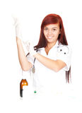 Female doctor pulling on surgical gloves Stock Photos