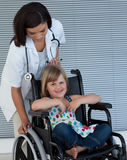 Female doctor pushing a wheelchair Stock Image