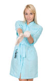 The female doctor putting on gloves. Stock Images