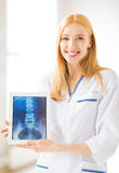 Female doctor with x-ray on tablet pc. Bright picture of female doctor with x-ray on tablet pc royalty free stock photography