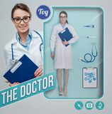 The female doctor realistic doll. Female doctor realistic doll with toy see through packaging, accessories set and smiling character holding a clipboard royalty free stock images