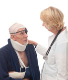 Female doctor reassuring senior patient. Old man with multiple injuries from accident being comforted by female doctor. Isolated on white stock image
