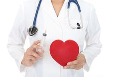 Female doctor with a red heart. A female doctor holding red heart love symbol stock images