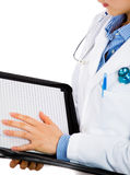 Female doctor reviewing patients chart Royalty Free Stock Image
