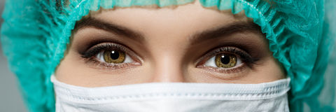 Female doctor's face wearing protective mask Stock Image