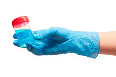 Female doctor's hand in blue glove holding transparent plastic sterile specimen collection contain Stock Photography