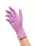 Female doctor's hand in purple sterilized surgical glove. Close up of female doctor's hand in purple sterilized surgical glove against white background Stock Images