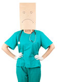 Female doctor with sad paper bag on his head Stock Photo
