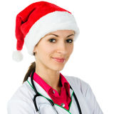 Female doctor in Santa hat Stock Photo