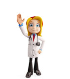 Female doctor with saying hi pose Stock Photography
