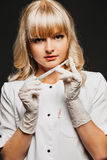 Female doctor with a scalpel. Royalty Free Stock Photography
