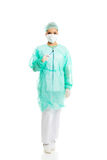 Female doctor with a scalpel. Female surgeon doctor with a scalpel Royalty Free Stock Photo