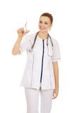 Female doctor with scissors in hand. Stock Photography