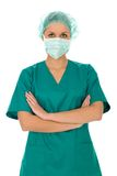 Female doctor in scrubs. Cap and face mask royalty free stock photography