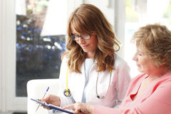 Female doctor with senior patient Royalty Free Stock Photo