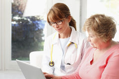 Female doctor with senior patient Royalty Free Stock Image