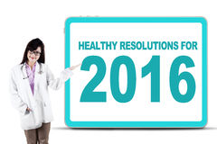 Female doctor show healthy resolution for 2016 Stock Image