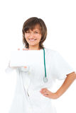 Female doctor showing blank card smiling Stock Images