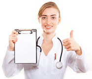 Female doctor showing blank clipboard Stock Photo