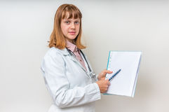 Female doctor showing blank medical clipboard stock photography