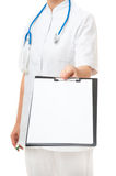 Female doctor showing clipboard Royalty Free Stock Photo
