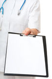Female Doctor showing clipboard with white sheet of paper Stock Image
