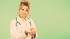 Female doctor showing copy space. Stock Photography