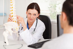 Female doctor showing doctor something Royalty Free Stock Images