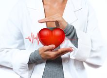 Female Doctor is showing heart shape. Medical Concept. Female Doctor is showing heart shape. Medical Insurance Concept royalty free stock image
