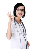 Female doctor showing OK sign Stock Images