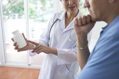 Doctors and patient discussing vitamins stock photos