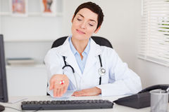 Female doctor showing pills Stock Photo
