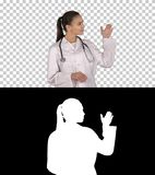 Female doctor showing something with hands extended Presentation, Alpha Channel stock images