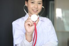 female doctor showing stethoscope for checkup at clinic. physician or medical practitioner holding stethoscope to auscultate stock photos