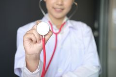 female doctor showing stethoscope for checkup at clinic. physician or medical practitioner holding stethoscope to auscultate royalty free stock photos
