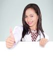 Female doctor showing thumbs up and bring an empty board Stock Image