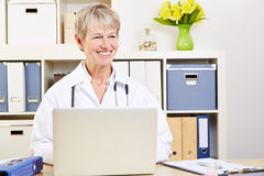Female doctor sitting at computer Stock Photo