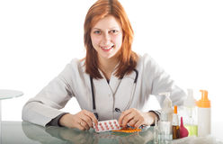 Female doctor sitting at a table Stock Image